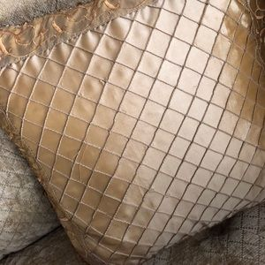 Gold decorative pattern with beading accent pillow